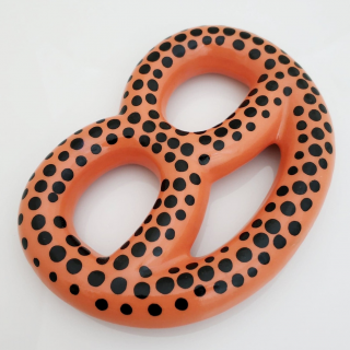 Orange pretzels with black dots